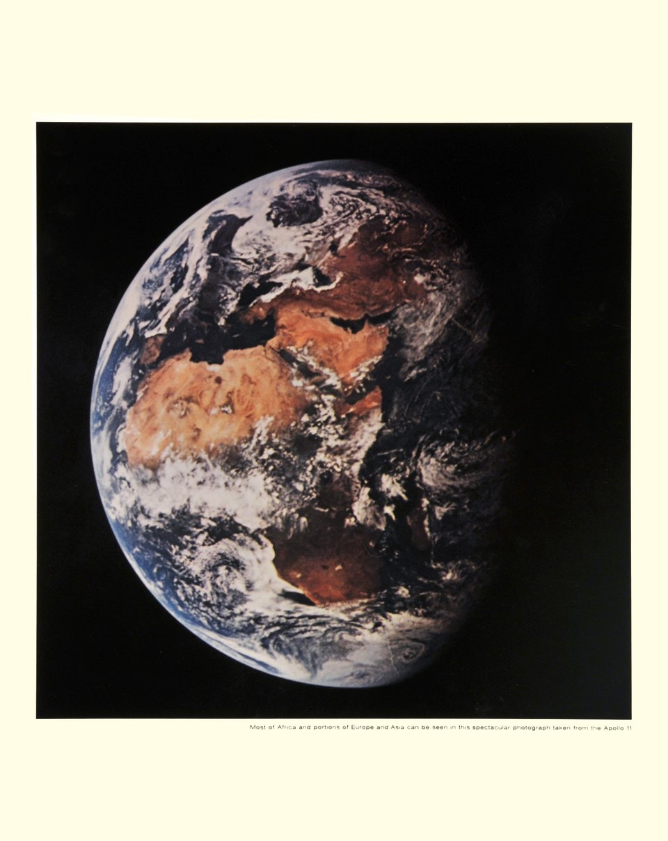 Apollo XI, Most of Africa and portions of Europe and Asia can be seen in this spectacular photograph taken from the Apollo 11 – Vintage poster – NASA – 1969